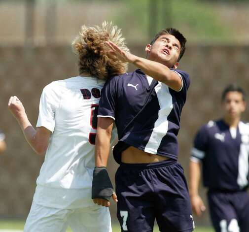 Boerne Champion midfielder Jacob Hernandez (7) and  Kilgore's Josh Thompson (5) go for a header in the UIL Boys 4A state soccer championship in Georgetown on Saturday April 16, 2011. (Erich Schlegel/Special to the Express-News) / ©2011 Erich Schlegel