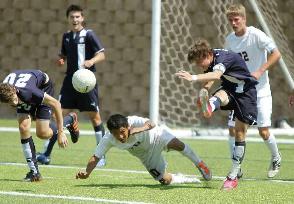 Boerne Champion midfielder Chris Schluter (8) clears the ball past Kilgore's Jose Barron (10) in the UIL Boys 4A state soccer championship in Georgetown on Saturday April 16, 2011. (Erich Schlegel/Special to the Express-News)