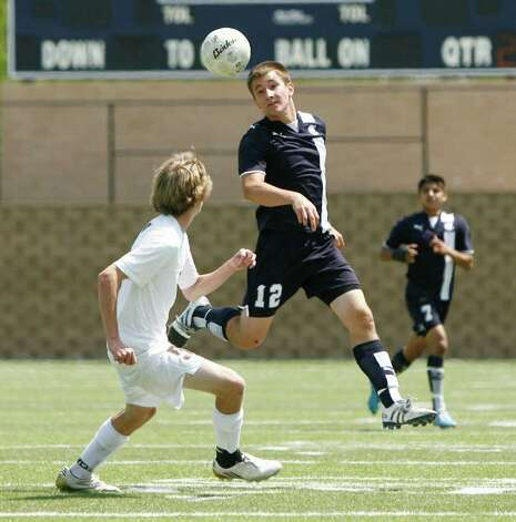 Boerne Champion's Connor Czar (12) heads the ball past Kilgore's Josh Thompson (5) in the UIL Boys 4A state soccer championship in Georgetown on Saturday April 16, 2011. (Erich Schlegel/Special to the Express-News) / ©2011 Erich Schlegel