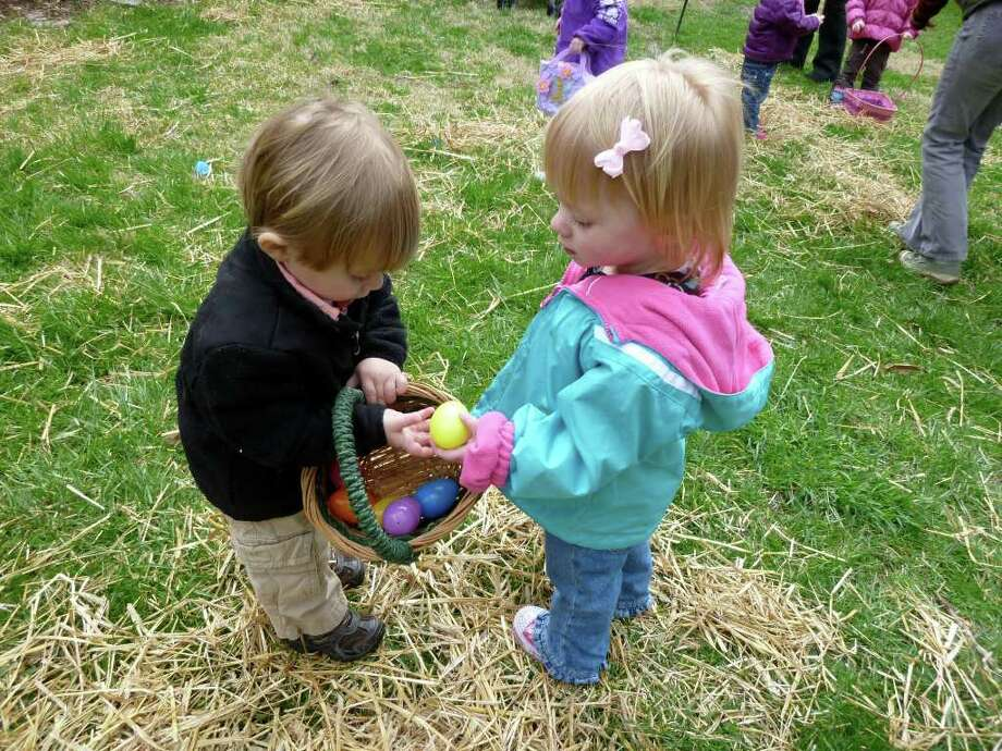 Nolan Hripak, 2, shares an Easter egg with Allie Kevalis, 2, at the Connecticut Audubon Society's Easter egg hunt Saturday. Photo: Contributed Photo/Mike Lauterborn / Fairfield Citizen contributed