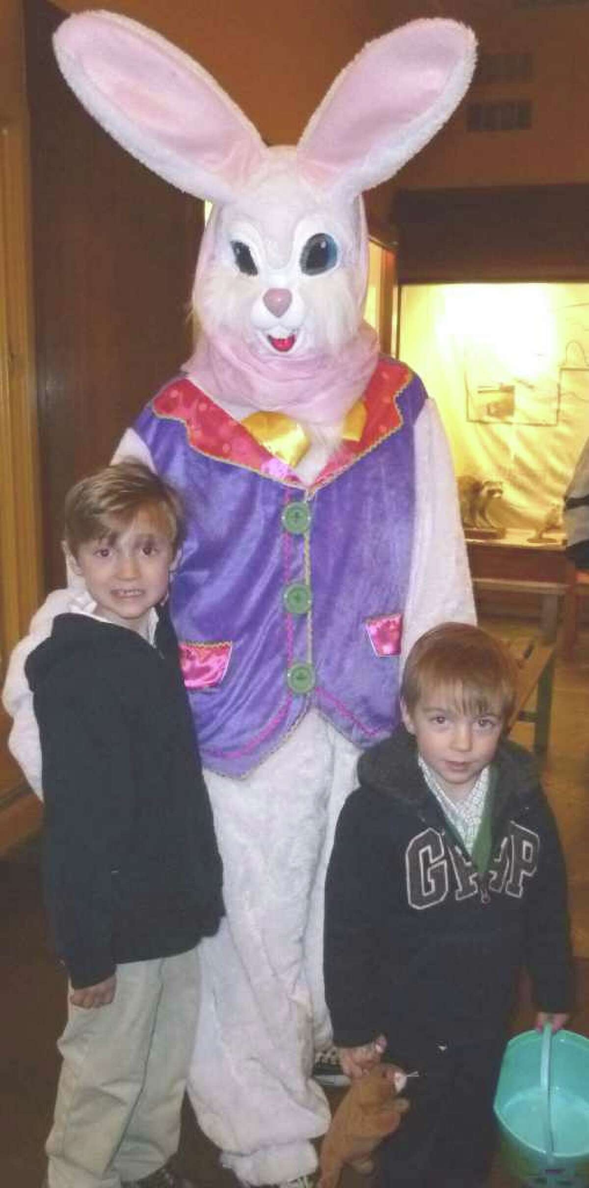 Robert Malgioglio, 7, of Monroe, with younger brother Ryan, 3, visit with the Easter bunny at the Connecticut Audubon Society's Easter celebration Saturday at its Burr Street nature preserve.
