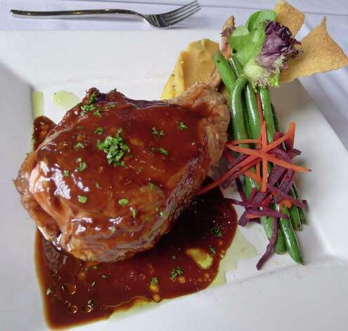 18oz Syuffed Veal Chop at Twenty8Tables resturant in Saratoga Springs,NY April 8, 2011. ( Michael P. Farrell/Times Union ) Photo: Michael P. Farrell / 00012709A