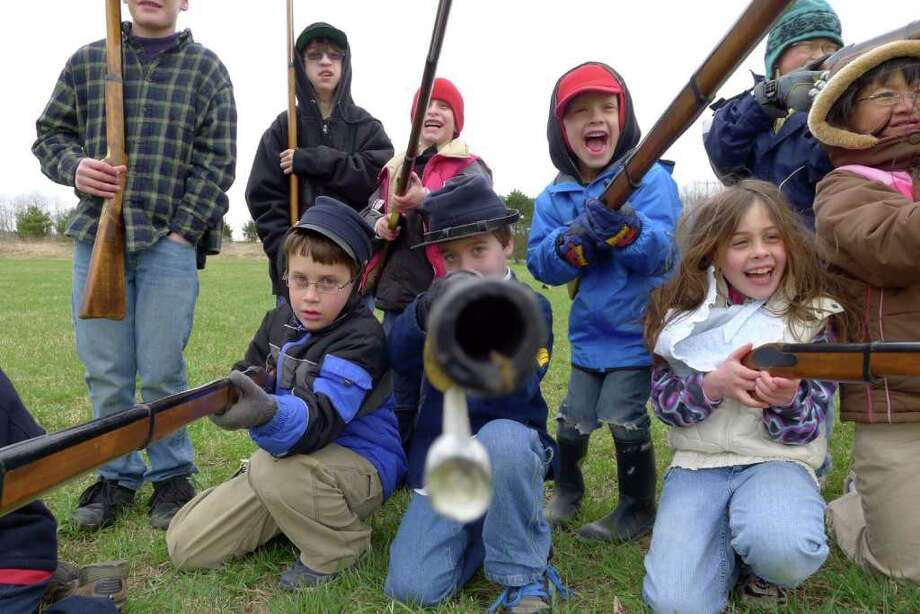 Eight-year-old Josh Eichenbaum of Clifton Park ,center, takes aim during a warfare demonstration for children as part of a Civil War Living History Day at the Mabee Farm Historic Site in Rotterdam Junction, NY Saturday April 16,2011. ( Michael P. Farrell/Times Union ) Photo: Michael P. Farrell / 00012721A