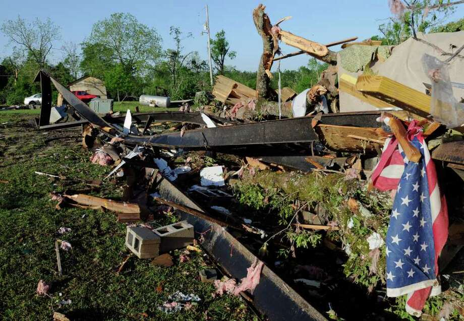 The wreckage of two mobile homes lies twisted on the ground in the Boone's Chapel in Autauga County, Ala., Saturday, April 16, 2011 after severe winds hit late Friday night, leaving three people in the area dead. (AP Photo/Montgomery Advertiser, Amanda Sowards) Photo: Amanda Sowards