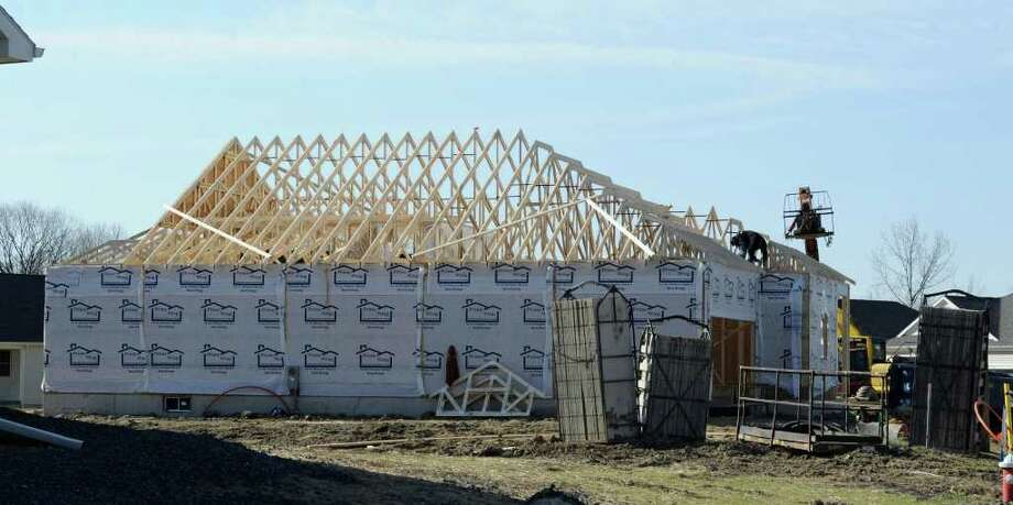 A home at 46 Sutherland Drive in Latham, N.Y. under construction April 15, 2011.   (Cindy Schultz / Times Union) Photo: Skip Dickstein