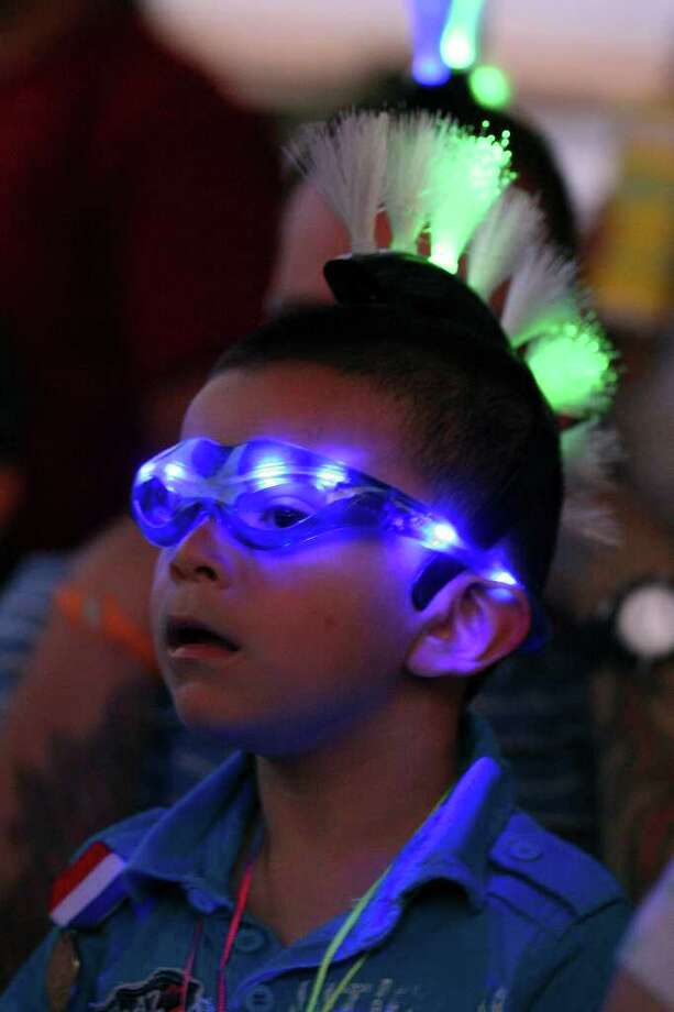 FOR METRO - Ray Guillen Jr., 3, takes in the sights during the Fiesta Flambeau Parade Saturday April 16, 2011. Photo: EDWARD A. ORNELAS, Express-News / SAN ANTONIO EXPRESS-NEWS (NFS)