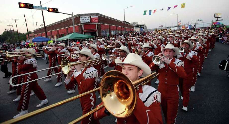 FOR METRO - Members of the University of Texas at Austin Longhorn Band perform during the Fiesta Flambeau Parade Saturday April 16, 2011. Photo: EDWARD A. ORNELAS, Express-News / SAN ANTONIO EXPRESS-NEWS (NFS)