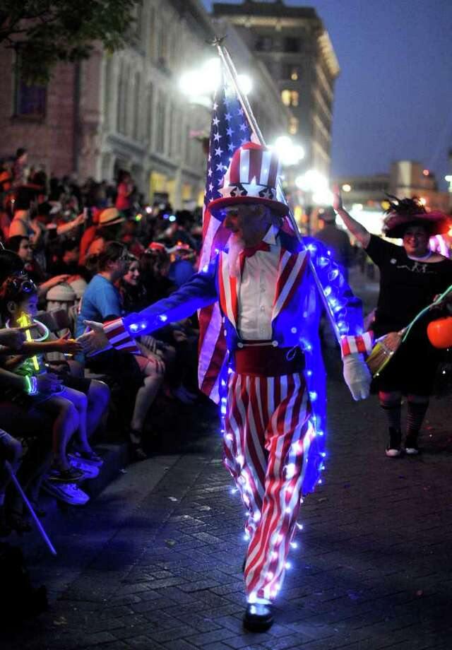 Ian Parkes, an immigrant from England, proudly wears the colors of the USA during the Fiesta Flambeau Parade on Saturday, April 16, 2011. BILLY CALZADA / gcalzada@express-news.net Photo: BILLY CALZADA, Express-News / gcalzada@express-news.net