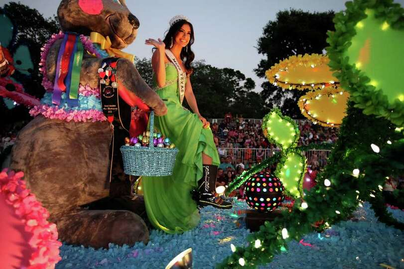 FOR METRO - Miss Texas USA Ana Rodriguez, the Grand Marshal of the Fiesta Flambeau Parade, shows her