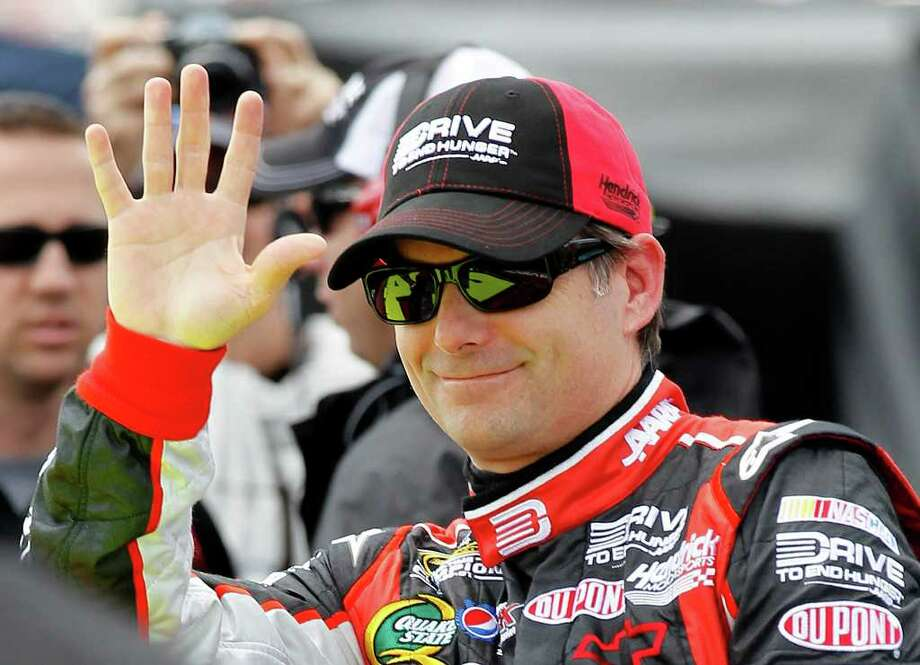 Driver Jeff Gordon waves to fans during qualifying for Sunday's Aaron's 499 NASCAR Sprint Cup series auto race at the Talladega Superspeedway, Saturday, April 16, 2011, in Talladega, Ala.  (AP Photo/Butch Dill) Photo: Butch Dill