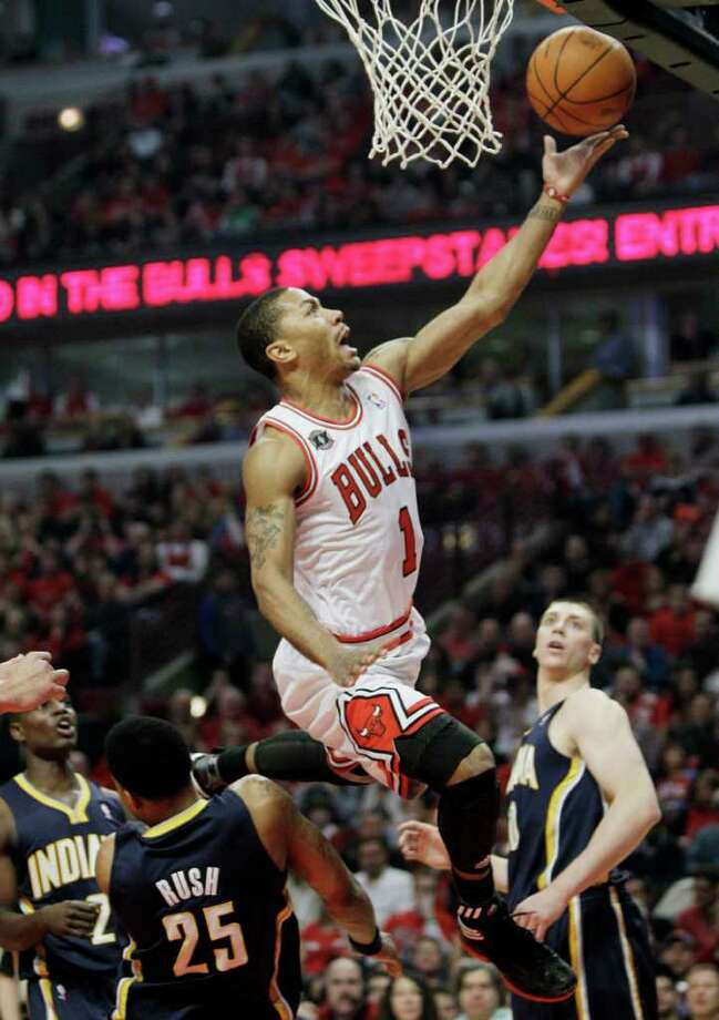 Chicago Bulls' Derrick Rose drives to the basket against the Indiana Pacers during the first quarter in Game 1 of a first-round NBA playoff basketball series in Chicago, Saturday, April 16, 2011. (AP Photo/Nam Y. Huh) Photo: Nam Y. Huh
