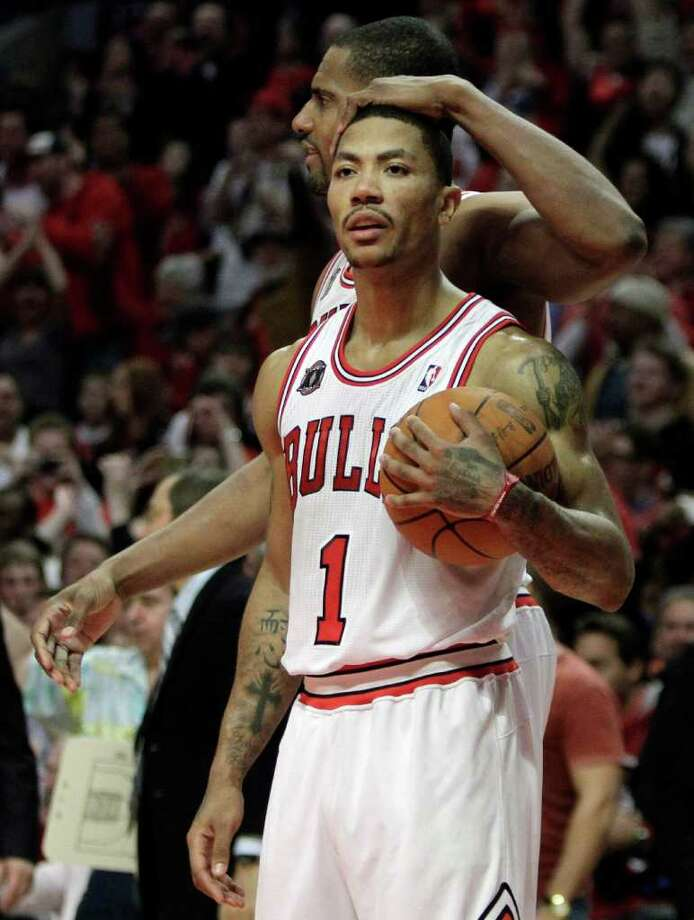 Chicago Bulls' Derrick Rose, front, celebrates with Kurt Thomas after the Bulls defeated the Indiana Pacers 104-99 in Game 1 of a first-round NBA playoffs basketball series in Chicago, Saturday, April 16, 2011. (AP Photo/Nam Y. Huh) Photo: Nam Y. Huh