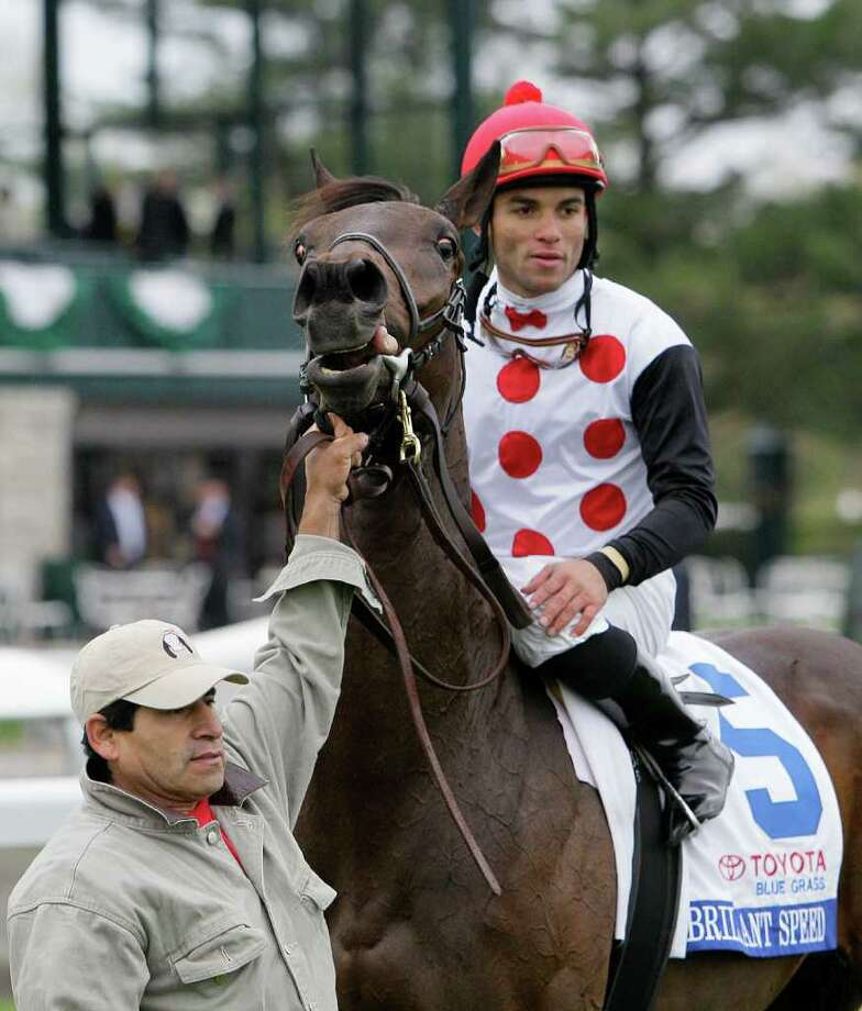 Brilliant Speed, ridden by jockey Joel Rosario, raises his head as he is held in the winner's circle after winning the Grade I Blue Grass Stakes at Keeneland in Lexington, Ky., Saturday, April 16, 2011.  (AP Photo/Ed Reinke) Photo: Ed Reinke
