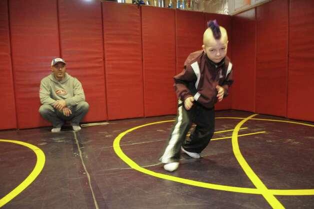 alfa img showing basement boys wrestling