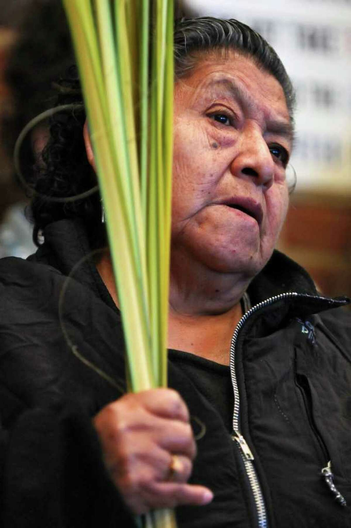 Maria Quispen, of Albany, of the Shrine Church of Our Lady of the Americas, holds palms during a bilingual palm blessing ceremony with members of St. John's Evangelical Lutheran Church on Palm Sunday, April 17, 2011, in Albany, NY. Members of Todos Los Hijos de Dios, of Amsterdam, were also there. ( Philip Kamrass / Times Union )