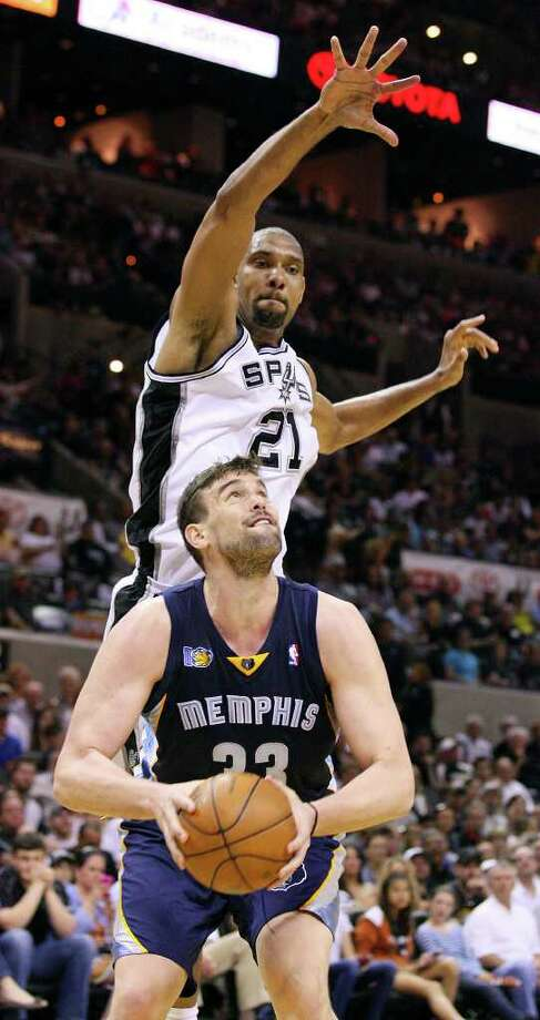 FOR SPORTS - San Antonio Spurs' Tim Duncan defends Memphis Grizzlies' Marc Gasol during second half action of game one in the NBA Western Conference First Round at the AT&T Center Sunday April 17, 2011. The Grizzlies won 101-98.   (PHOTO BY EDWARD A. ORNELAS/eaornelas@express-news.net) Photo: EDWARD A. ORNELAS, SAN ANTONIO EXPRESS-NEWS / SAN ANTONIO EXPRESS-NEWS (NFS)
