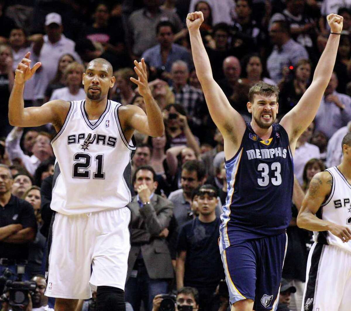 FOR SPORTS - San Antonio Spurs' Tim Duncan (left) reacts at the end of the game as Memphis Grizzlies' Marc Gasol celebrates in game one of the NBA Western Conference First Round at the AT&T Center Sunday April 17, 2011. The Grizzlies won 101-98. (PHOTO BY EDWARD A. ORNELAS/eaornelas@express-news.net)