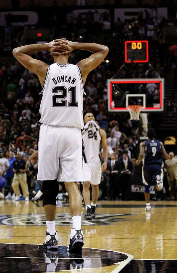 SPURS -- San Antonio Spurs Tim Duncan reacts as time runs out in the first game against the Memphis Grizzlies in the NBA Western Conference First Round at the AT&T Center, Sunday, April 17, 2011. The Grizzlies won 101-98.JERRY LARA/glara@express-news.net Photo: JERRY LARA, San Antonio Express-News / SAN ANTONIO EXPRESS-NEWS (NFS)