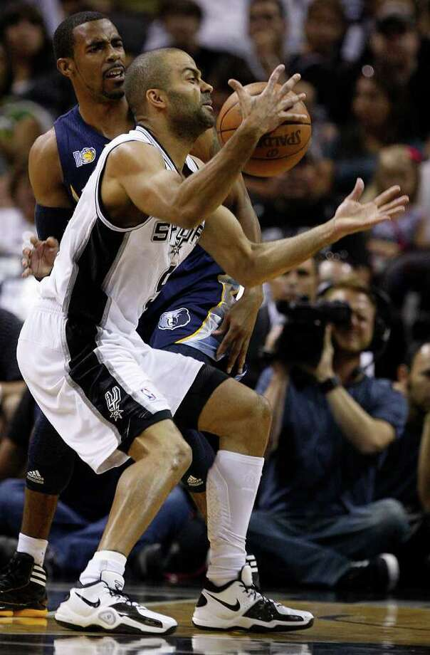 SPURS -- San Antonio Spurs Tony Parker loses the ball under pressure from Memphis Grizzlies Mike Conley during the first half of game one in the NBA Western Conference First Round at the AT&T Center, Sunday, April 17, 2011. The Spurs lost, 101-98. JERRY LARA/glara@express-news.net Photo: JERRY LARA, San Antonio Express-News / SAN ANTONIO EXPRESS-NEWS (NFS)