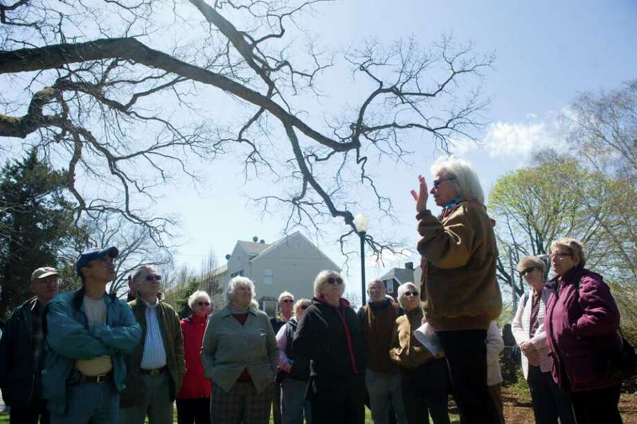 Local historian Renee Kahn leads a tour of Woodland Cemetery in Stamford, Conn., April 17, 2011. The tour was sponsored by the Historic Neighborhood Preservation Program. Photo: Keelin Daly / Stamford Advocate