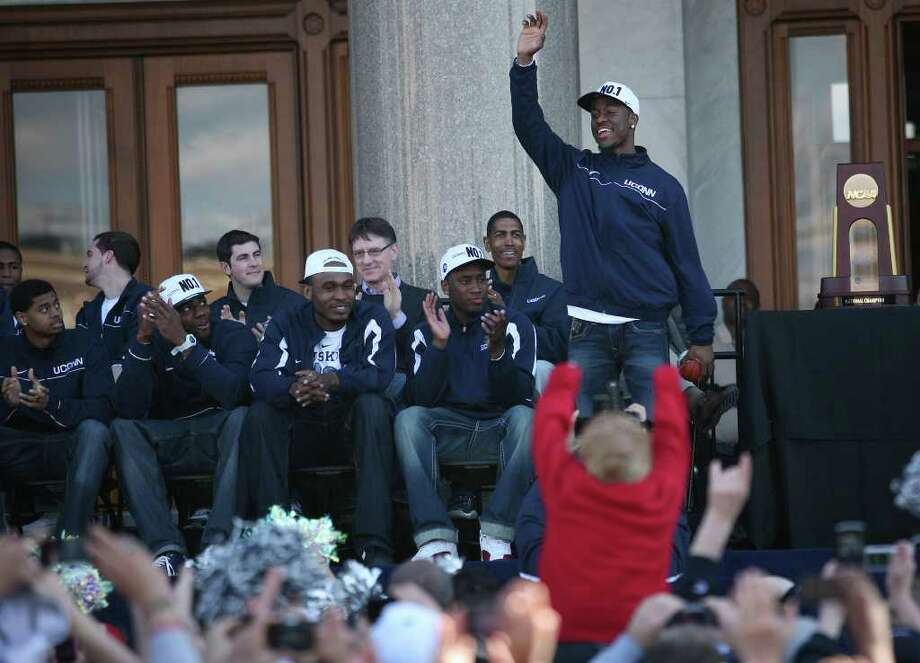 UConn men's basketball star Kemba Walker waves to the crowd at a rally on the Capitol steps following his team's NCAA Championship victory parade in Hartford on Sunday, April 17, 2011. Photo: Brian A. Pounds / Connecticut Post