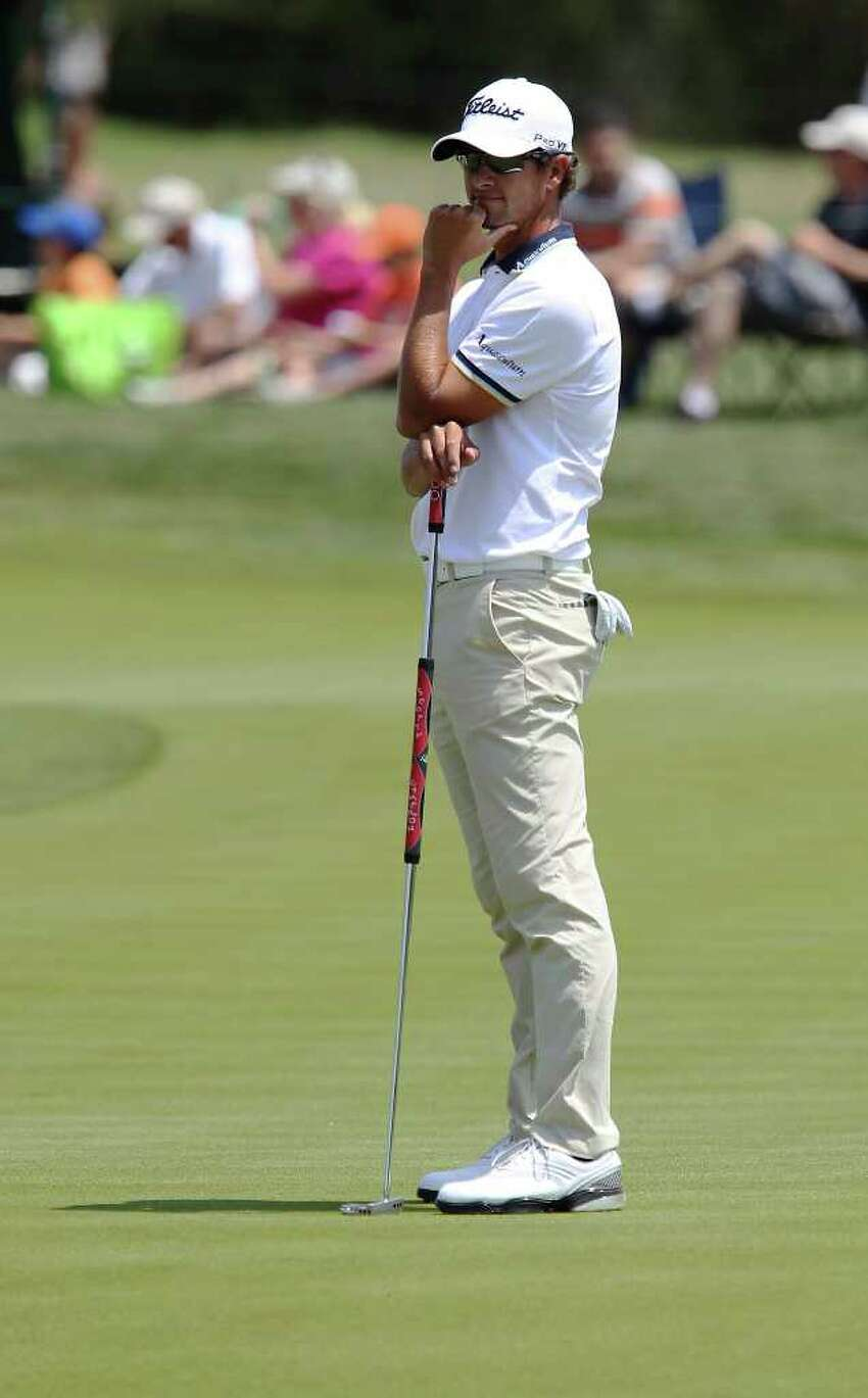 2010 champion Adam Scott ponders a missed putt on No. 7 during the final round at the 2011 Valero Texas Open at the AT&T Oaks Course at TPC San Antonio on Saturday, April 16, 2011. Scott finished 23rd. Kin Man Hui/kmhui@express-news.net