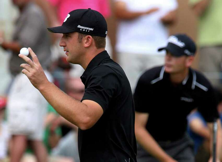 Kevin Chappell acknowledges the crowd after his par putt on No. 16 in the final round at the 2011 Valero Texas Open at the AT&T Oaks Course at TPC San Antonio on Saturday, April 16, 2011. Chappell finished tied for second place. Kin Man Hui/kmhui@express-news.net
