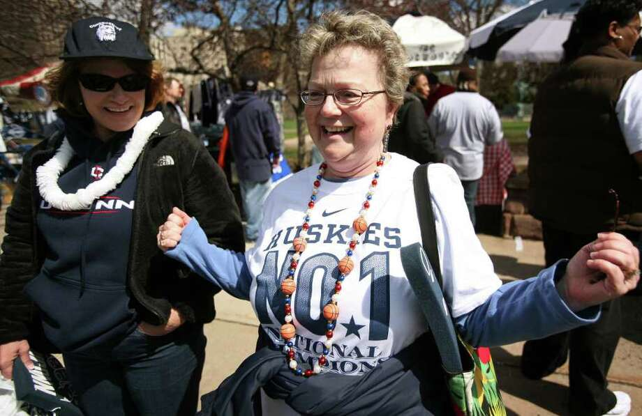 Diann Drenosky, left of Trumbull, and Nancy Messinger of Newtown, attend the UConn men's basketball NCAA Championship victory parade in Hartford on Sunday, April 17, 2011. Messinger said that she is such a fan that she chased down Governor Malloy at Bradley International Airport to plead with him that the parade take place. Photo: Brian A. Pounds / Connecticut Post