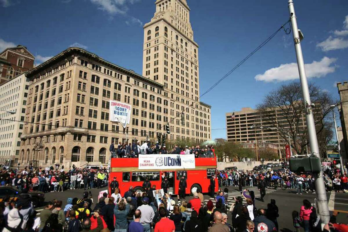 The UConn men's basketball team rides atop a double decker bus during the NCAA Championship victory parade in downtown Hartford on Sunday, April 17, 2011.