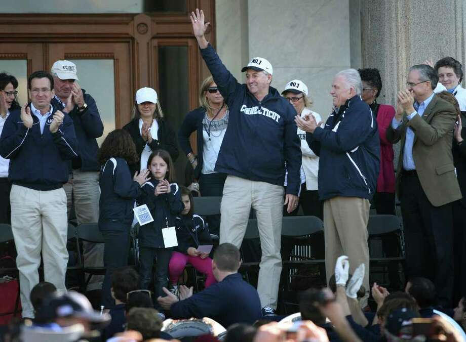 Coach Jim Calhoun waves to the crowd during a rally at the Capitol following the men's basketball team's NCAA Championship parade in Hartford on Sunday, April 17, 2011. Photo: Brian A. Pounds / Connecticut Post
