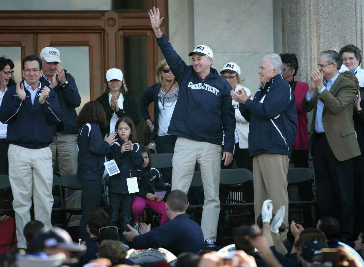 Coach Jim Calhoun waves to the crowd during a rally at the Capitol following the men's basketball team's NCAA Championship parade in Hartford on Sunday, April 17, 2011.