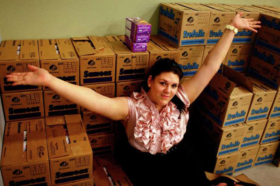 Hannah Richmond, 14, acknowledges the boxes of Girl Scout Cookies that surround her at the Girl Scouts of Southwest Texas office. Photo: LISA KRANTZ, Lisa Krantz/Express-News / SAN ANTONIO EXPRESS-NEWS