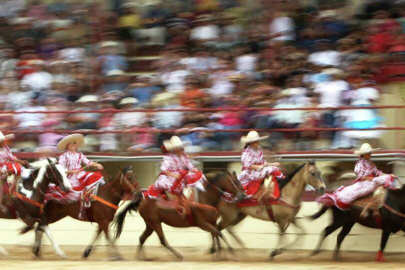 Escaramuza las Espuelas performs during the Fiesta Charreada at the San Antonio Charro Ranch, Sunday