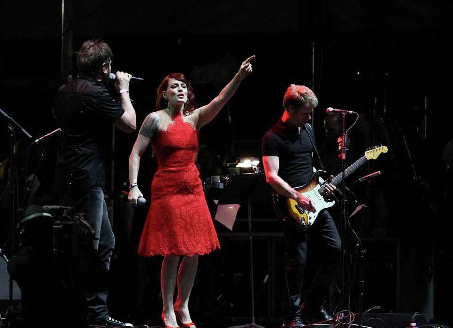 Simon Le Bon of Duran Duran, left, and Ana Matronic of the Scissor Sisters perform during the last day of the Coachella Valley Music & Arts Festival, Sunday, April 17 2011, in Indio, Calif. Photo: AP