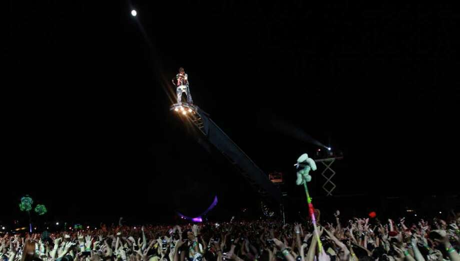 Kanye West arrives for his performance on a lift over the crowd during the finale concert of the Coachella Valley Music & Arts Festival, Sunday, April 17 2011, in Indio, Calif. Photo: AP