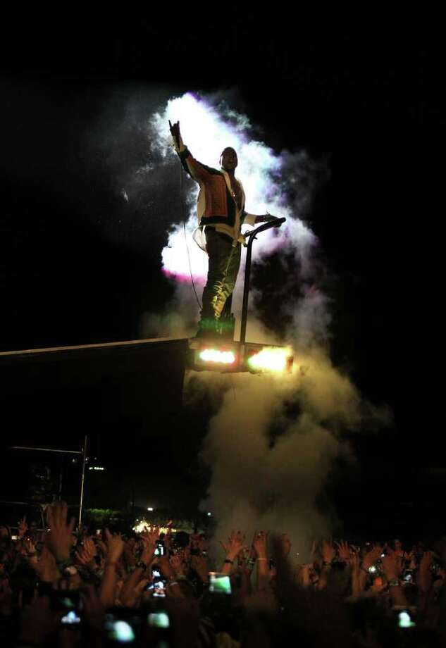 Singer Kanye West arrives for his performance on a lift over the crowd during the finale concert of the Coachella Valley Music & Arts Festival, Sunday, April 17 2011, in Indio, Calif. Photo: AP