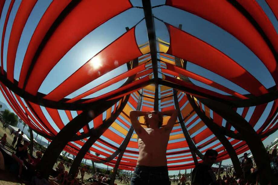 An art installation provides shade for festival goers on the last day of the Coachella Valley Music & Arts Festival, Sunday, April 17 2011, in Indio, Calif. Photo: AP