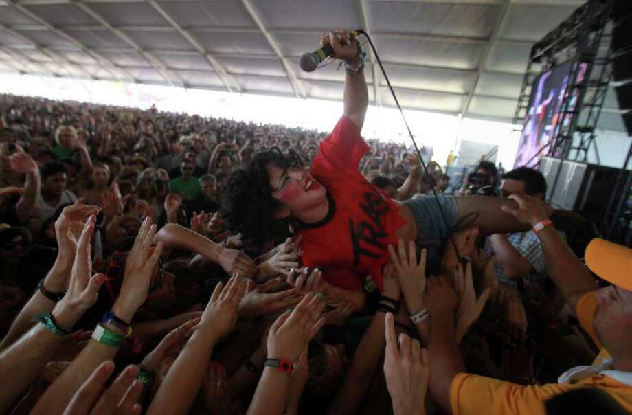 Lead singer of CSS, Luísa Hanae Matsushita, better known by her stage name Lovefoxxx, dives into the crowd during performance at the Coachella Valley Music & Arts Festival, Sunday, April 17 2011, in Indio, Calif. Photo: AP