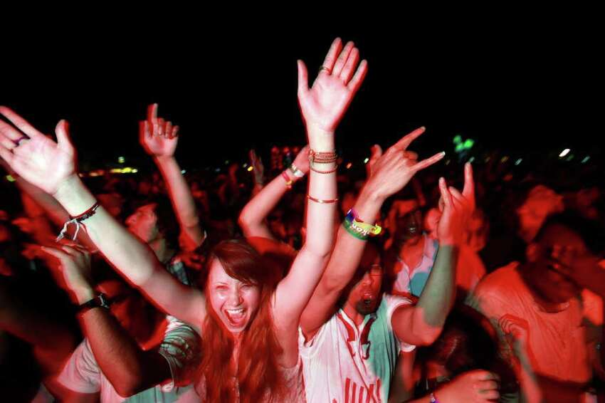 Fans cheer at the outdoor stage during The Kills performance at Coachella Valley Music and Arts Festival, Saturday, April 16 2011, in Indio, Calif.
