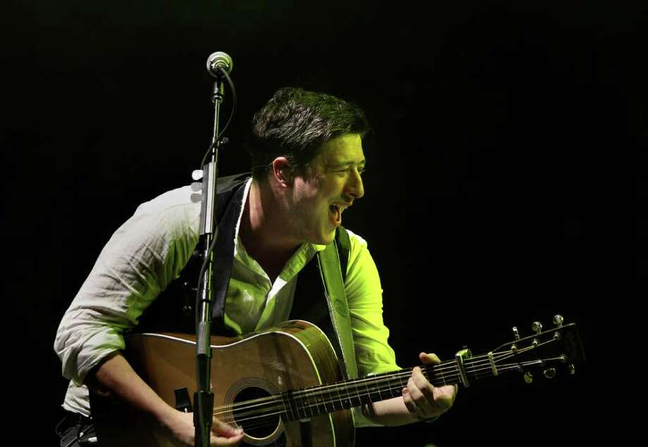 Mumford and Sons' lead singer Marcus Mumford during performance at Coachella Valley Music and Arts Festival, Saturday, April 16 2011, in Indio, Calif. Photo: AP