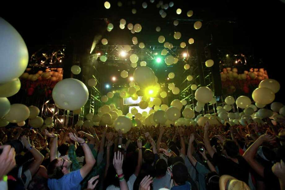 Inflated balloons fall from the main stage as Arcade Fire delivers their finale song, and a gift for the fans at Coachella Valley Music and Arts Festival, Saturday, April 16 2011, in Indio, Calif. Photo: AP