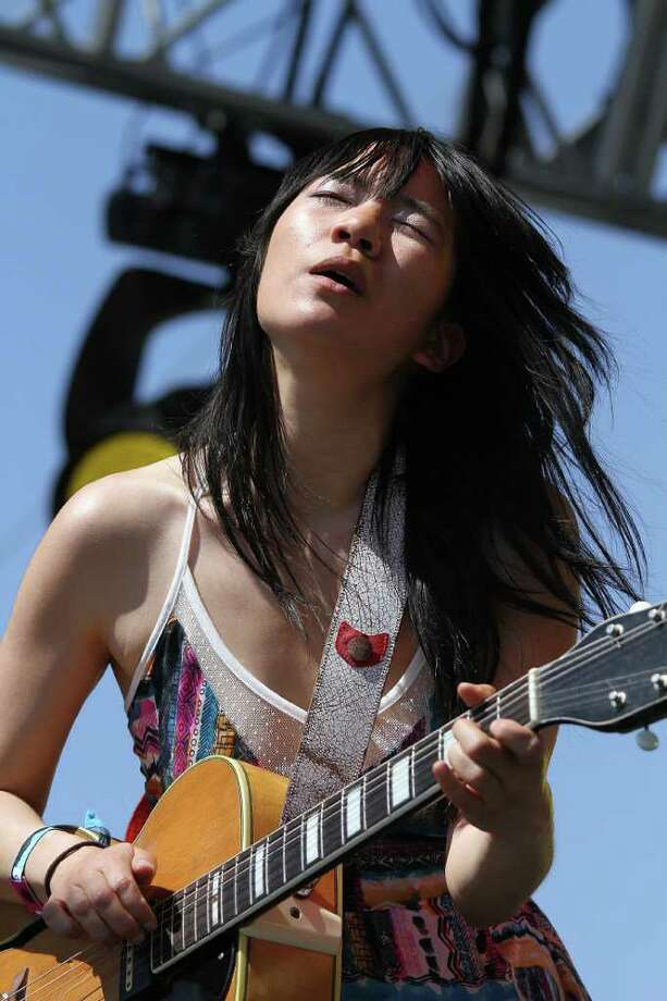 Thao Nguyen performs with band, The Get Down Stay Down during performance at Coachella Valley Music and Arts Festival, Saturday, April 16 2011, in Indio, Calif. Photo: AP