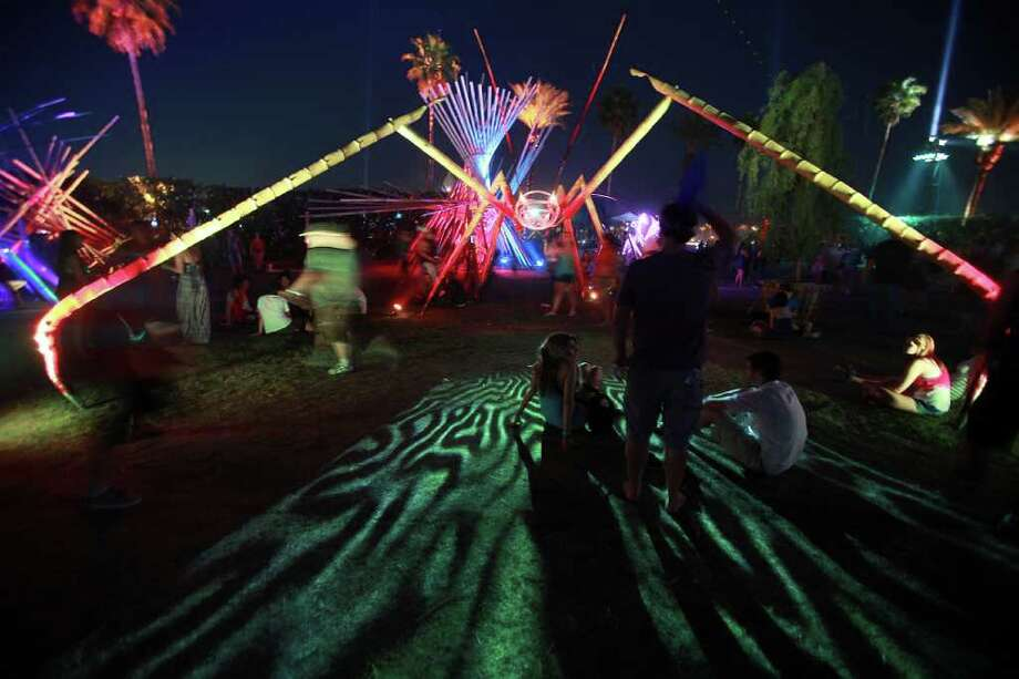 Sculptures shaped as space bugs are part of the art installations at 12th Coachella Valley Music and Arts Festival, Friday, April 15 2011, in Indio, Calif. Photo: AP