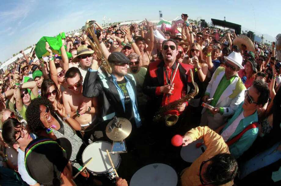 Ozomatli performs from the fan's viewing area during their set at Coachella Valley Music and Arts Festival, Friday, April 15 2011, in Indio, Calif. Photo: AP