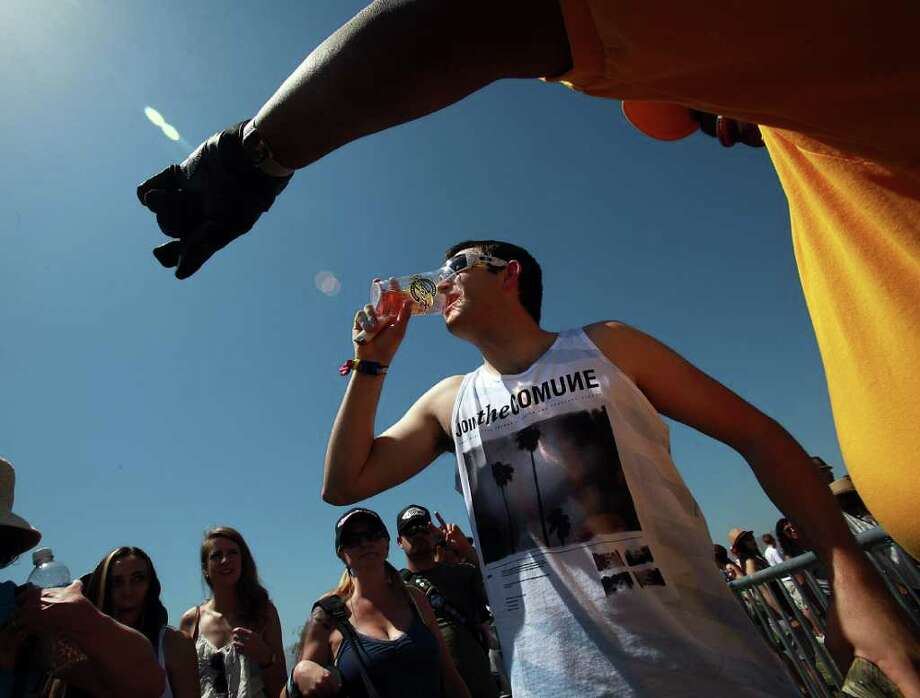 Chad Myers, 23, drinks beer before passing through security at 12th Coachella Valley Music and Arts Festival, Friday, April 15 2011, in Indio, Calif. Photo: AP