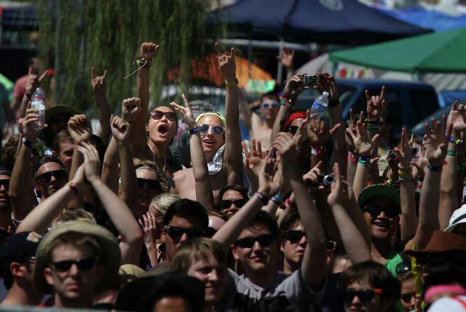 Campers cheer at the opening of the 12th Coachella Valley Music and Arts Festival, Friday, April 15 2011, in Indio, Calif. Photo: AP