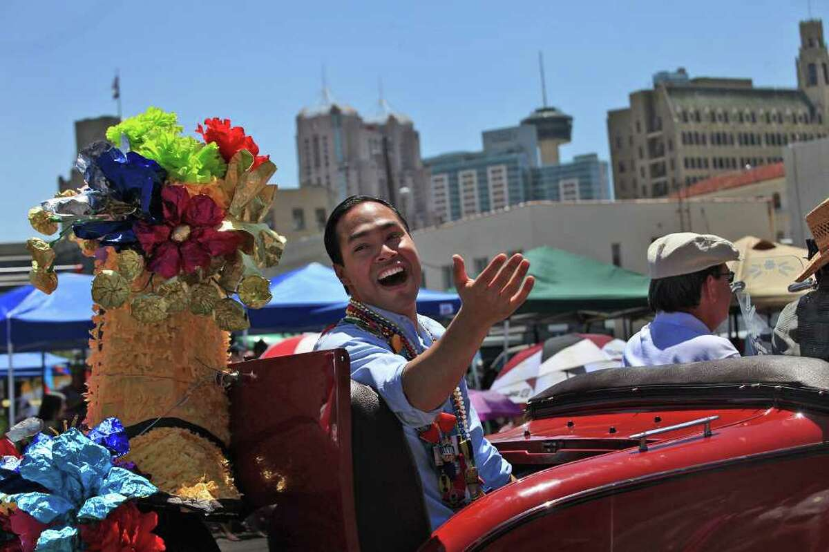 metro - Mayor Julian Castro explains that he ran out of medals after spectators asked for them as he rides in the Battle of Flowers Parade on Friday, April 15, 2011. LISA KRANTZ/lkrantz@express-news.net