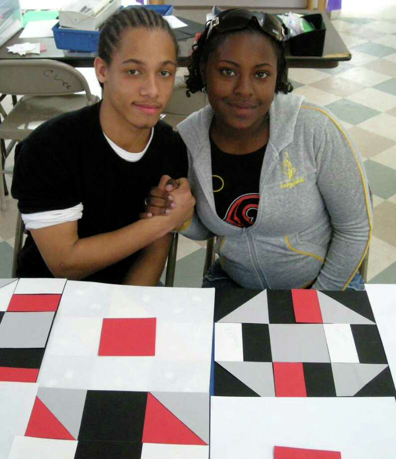 Local kids work on a paper quilt during a meeting of the Peace by Piece Project. Photo: Contributed Photo / Norwalk Citizen