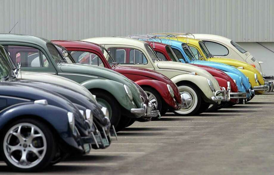 More than 140 Volkswagen Beetle were gathered to participate in an exhibition at the factory in Puebla, Mexico, on Aug. 1, 2003.  AFP PHOTO/Rafael DURAN. Photo: AFP, AFP/Getty Images / 2003 AFP
