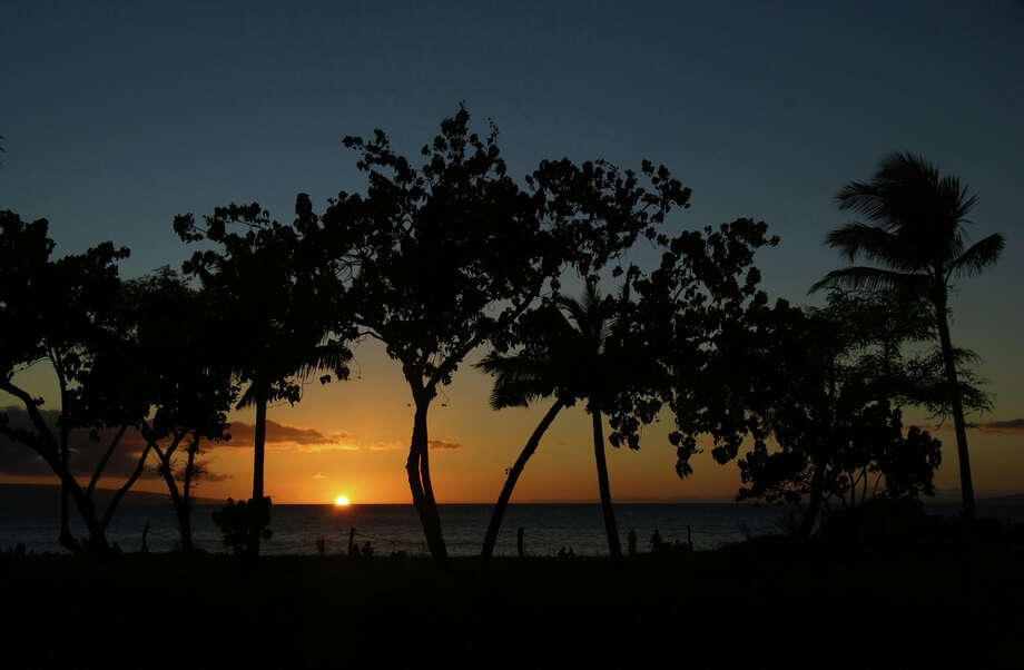 The sun sets off of Kaanapali Beach in Maui, offering tourists a serene glimpse of the postcard-like view. JOSHUA TRUDELL / SPECIAL TO THE EXPRESS-NEWS